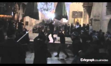 Christian clergymen celebrate Christmas<br>by beating each other up at the Church<br>of the Nativity in Bethlehem