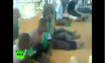Libyan rebels cage black Africans, force-feed them flags